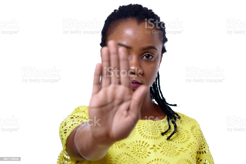 "Woman with hand outstretched to indicate ""stop"""
